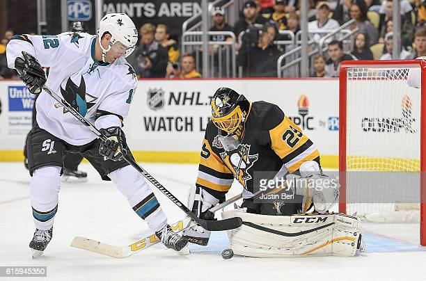 MarcAndre Fleury of the Pittsburgh Penguins makes the save against Patrick Marleau of the San Jose Sharks in the third period during the game at PPG...