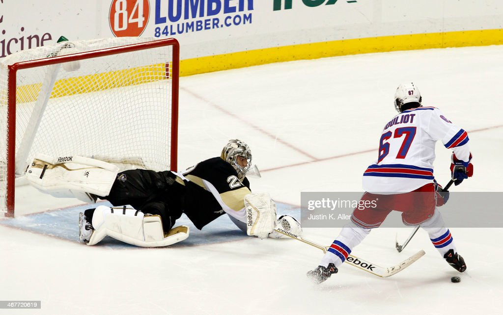 Marc-Andre Fleury #29 of the Pittsburgh Penguins poke checks Benoit Pouliot #67 of the New York Rangers during the shootout at Consol Energy Center on February 7, 2014 in Pittsburgh, Pennsylvania.