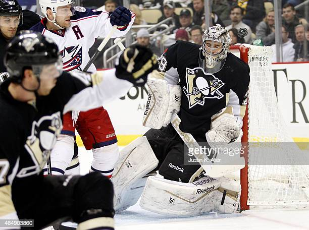 MarcAndre Fleury of the Pittsburgh Penguins protects the net during the game against the Columbus Blue Jackets at Consol Energy Center on March 1...
