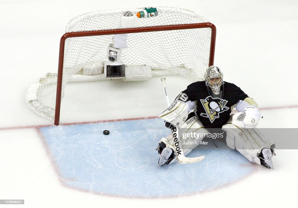 <a gi-track='captionPersonalityLinkClicked' href=/galleries/search?phrase=Marc-Andre+Fleury&family=editorial&specificpeople=233779 ng-click='$event.stopPropagation()'>Marc-Andre Fleury</a> #29 of the Pittsburgh Penguins reacts after giving up a goal in the third period against the Philadelphia Flyers in Game Two of the Eastern Conference Quarterfinals during the 2012 NHL Stanley Cup Playoffs at Consol Energy Center on April 13, 2012 in Pittsburgh, Pennsylvania. The Flyers defeated the Penguins 7-5.