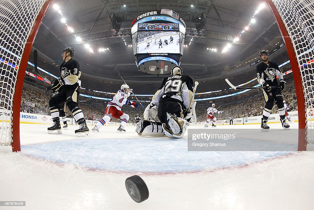 <a gi-track='captionPersonalityLinkClicked' href=/galleries/search?phrase=Marc-Andre+Fleury&family=editorial&specificpeople=233779 ng-click='$event.stopPropagation()'>Marc-Andre Fleury</a> #29 of the Pittsburgh Penguins reacts after giving up a goal by Benoit Pouliot #67 of the New York Rangers in Game One of the Second Round of the 2014 Stanley Cup Playoffs at Consol Energy Center on May 2, 2014 in Pittsburgh, Pennsylvania. New York won the game 3-2 in overtime.
