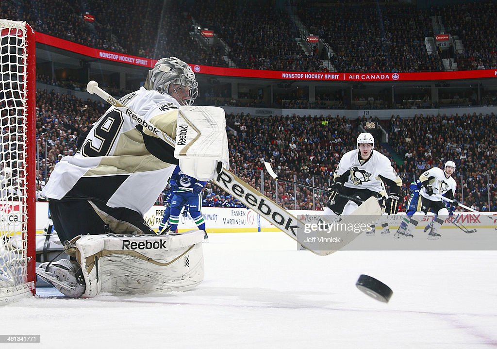 <a gi-track='captionPersonalityLinkClicked' href=/galleries/search?phrase=Marc-Andre+Fleury&family=editorial&specificpeople=233779 ng-click='$event.stopPropagation()'>Marc-Andre Fleury</a> #29 of the Pittsburgh Penguins redirects the puck during their NHL game against the Vancouver Canucks at Rogers Arena January 7, 2014 in Vancouver, British Columbia, Canada. Pittsburgh won 5-4.