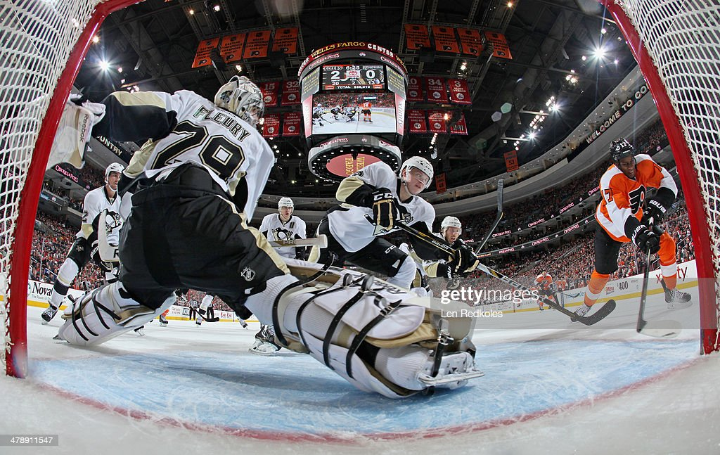 <a gi-track='captionPersonalityLinkClicked' href=/galleries/search?phrase=Marc-Andre+Fleury&family=editorial&specificpeople=233779 ng-click='$event.stopPropagation()'>Marc-Andre Fleury</a> #29 of the Pittsburgh Penguins slides across his crease as teammte Olli Maatta #3 defends against <a gi-track='captionPersonalityLinkClicked' href=/galleries/search?phrase=Wayne+Simmonds&family=editorial&specificpeople=4212617 ng-click='$event.stopPropagation()'>Wayne Simmonds</a> #17 of the Philadelphia Flyers on March 15, 2014 at the Wells Fargo Center in Philadelphia, Pennsylvania.