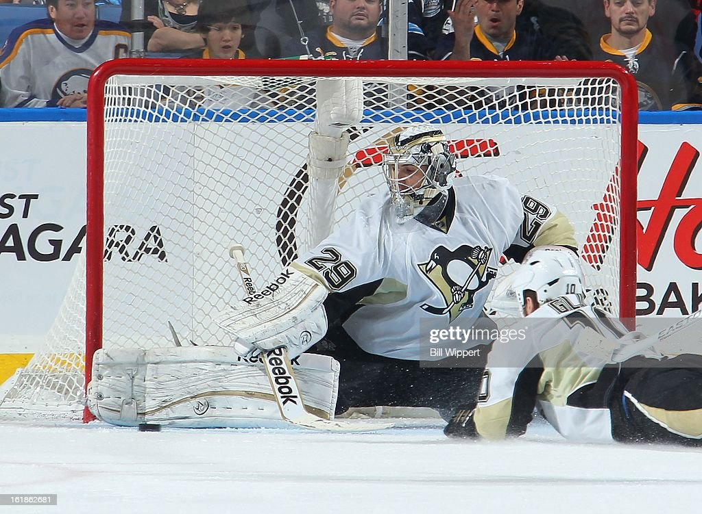 Marc-Andre Fleury #29 of the Pittsburgh Penguins sprawls to make a second period pad save against the Buffalo Sabres on February 17, 2013 at the First Niagara Center in Buffalo, New York.