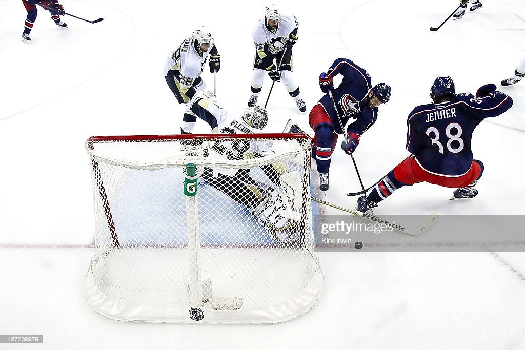 <a gi-track='captionPersonalityLinkClicked' href=/galleries/search?phrase=Marc-Andre+Fleury&family=editorial&specificpeople=233779 ng-click='$event.stopPropagation()'>Marc-Andre Fleury</a> #29 of the Pittsburgh Penguins stops a shot from <a gi-track='captionPersonalityLinkClicked' href=/galleries/search?phrase=Nick+Foligno&family=editorial&specificpeople=537821 ng-click='$event.stopPropagation()'>Nick Foligno</a> #71 of the Columbus Blue Jackets during the second period of Game Six of the First Round of the 2014 NHL Stanley Cup Playoffs at Nationwide Arena on April 28, 2014 in Columbus, Ohio. Pittsburgh defeated Columbus 4-3 to win the series four games to two.