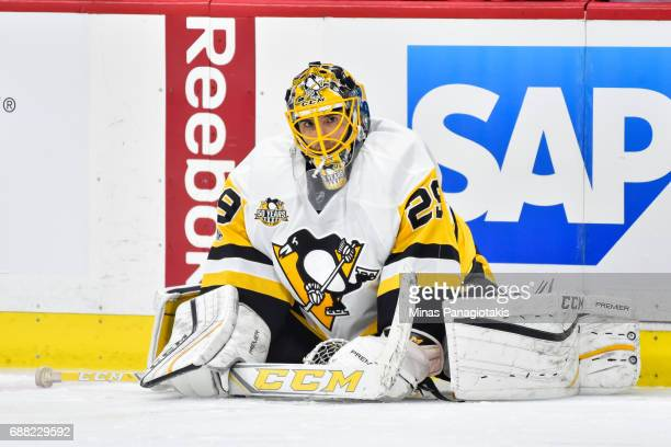 MarcAndre Fleury of the Pittsburgh Penguins stretches during the warmup against the Ottawa Senators in Game Six of the Eastern Conference Final...