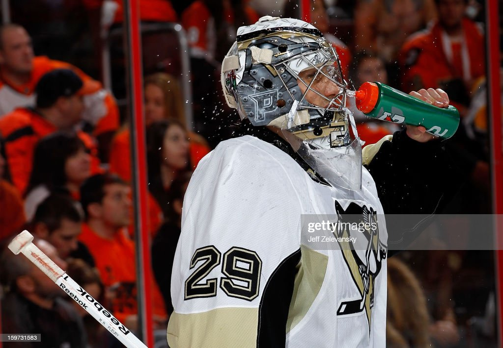 Marc-Andre Fleury #29 of the Pittsburgh Penguins takes a drink during the season opener against the Philadelphia Flyers at Wells Fargo Center on January 19, 2013 in Philadelphia, Pennsylvania.