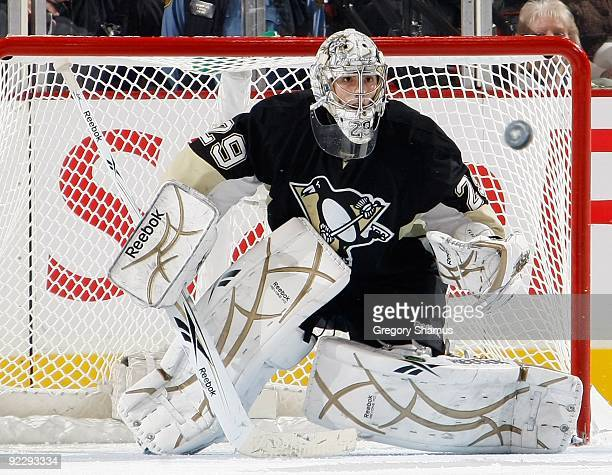 MarcAndre Fleury of the Pittsburgh Penguins watches an oncoming shot against the St Louis Blues on October 20 2009 at Mellon Arena in Pittsburgh...