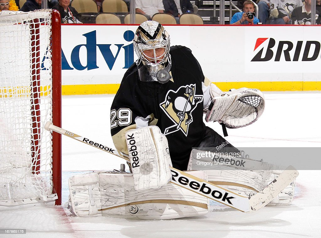 <a gi-track='captionPersonalityLinkClicked' href=/galleries/search?phrase=Marc-Andre+Fleury&family=editorial&specificpeople=233779 ng-click='$event.stopPropagation()'>Marc-Andre Fleury</a> #29 of the Pittsburgh Penguins watches the loose puck during the third period against the New York Islanders in Game One of the Eastern Conference Quarterfinals during the 2013 NHL Stanley Cup Playoffs at Consol Energy Center on May 1, 2013 in Pittsburgh, Pennsylvania. Pittsburgh won the game 5-0.
