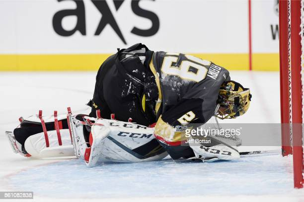 MarcAndre Fleury of the Vegas Golden Knights is shaken up after colliding with Anthony Mantha of Detroit Red Wings during the game at TMobile Arena...