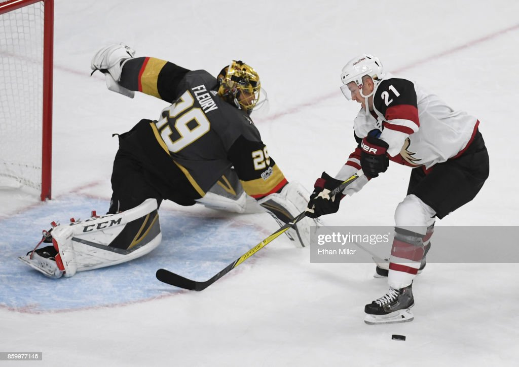 Marc-Andre Fleury #29 of the Vegas Golden Knights knocks the puck way from Derek Stepan #21 of the Arizona Coyotes during the second period of the Golden Knights' inaugural regular-season home opener at T-Mobile Arena on October 10, 2017 in Las Vegas, Nevada.