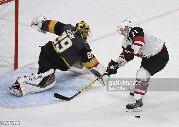 MarcAndre Fleury of the Vegas Golden Knights knocks the puck way from Derek Stepan of the Arizona Coyotes during the second period of the Golden...