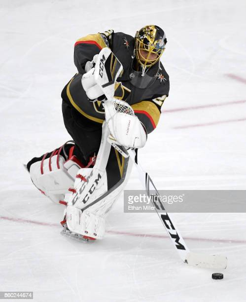 MarcAndre Fleury of the Vegas Golden Knights passes the puck against the Arizona Coyotes during the Golden Knights' inaugural regularseason home...