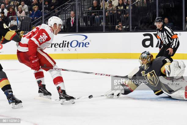 MarcAndre Fleury of the Vegas Golden Knights poke checks the puck away from Anthony Mantha of the Detroit Red Wings during the game at TMobile Arena...