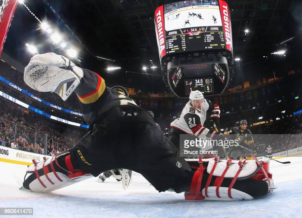 MarcAndre Fleury of the Vegas Golden Knights tends net against Derek Stepan of the Arizona Coyotes during the Golden Knights' inaugural regularseason...