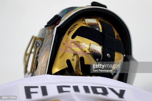 MarcAndre Fleury of the Vegas Golden Knights wears a 'Vegas Strong' sticker on his mask before taking on the Dallas Stars at American Airlines Center...