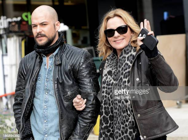 MarcAndre Grondin and Kim Cattrall take a break from shooting on the set of 'Sensitive Skin' on November 4 2013 in Toronto Canada