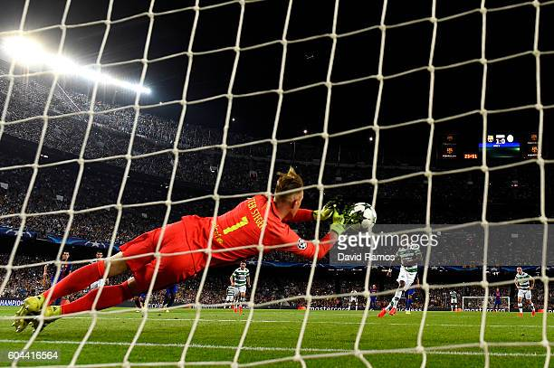 MarcAndre ter Stegen of Barcelona saves a penalty from Moussa Dembele of Celtic during the UEFA Champions League Group C match between FC Barcelona...