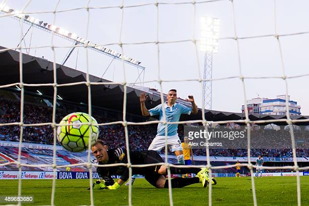 MarcAndre Ter Stegen of FC Barcelona looks on as Manuel Agudo 'Nolito' of Celta Vigo scores the opening goal and Iago Aspas celebrates during the La...