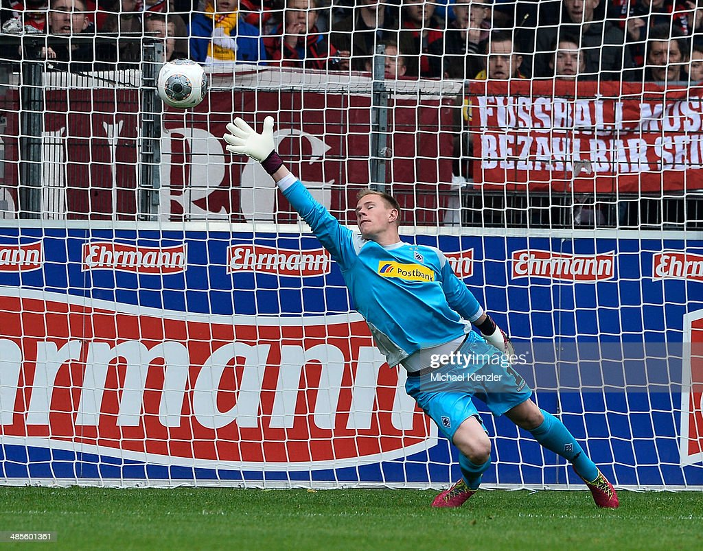 Marc-Andre Ter Stegen of Moenchengladbach conceds a goal from Admir Mehmedi of Freiburg (not in picture) during the Bundesliga match between SC Freiburg and Borussia Moenchengladbach at Mage Solar Stadium on April 19, 2014 in Freiburg, Germany.