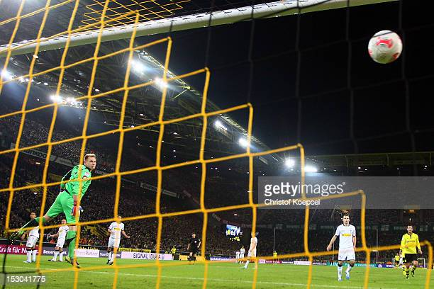MarcAndre ter Stegen of Moenchengladbach gets the third goal of Marco Reus of Dortmund during the Bundesliga match between Borussia Dortmund and VfL...