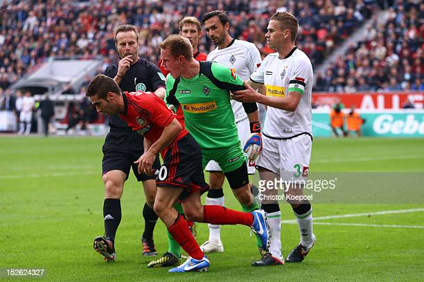 MarcAndre ter Stegen of Moenchengladbach shouts at Ramos Carjaval of Leverkusen after being attacked during the Bundesliga match between Bayer 04...