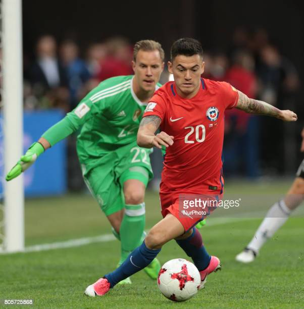 MarcAndre Ter Stegen of the Germany national football team and Charles Aranguiz of the Chile national football team vie for the ball during the 2017...