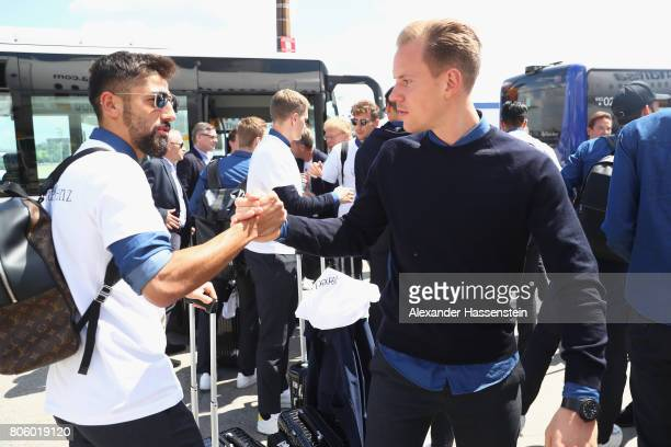 MarcAndre terStegen of Germany shake hands with his team mate Kerem Demirbay after her arrival with his team at Frankfurt am Main Interantional...