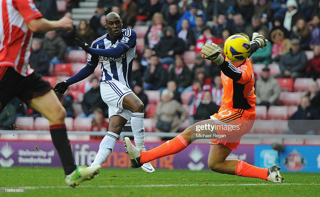<a gi-track='captionPersonalityLinkClicked' href=/galleries/search?phrase=Marc-Antoine+Fortune&family=editorial&specificpeople=2463780 ng-click='$event.stopPropagation()'>Marc-Antoine Fortune</a> of West Brom scores to make it 4-2 during the Barclays Premier League match between Sunderland and West Bromwich Albion at the Stadium of Light on November 24, 2012 in Sunderland, England.