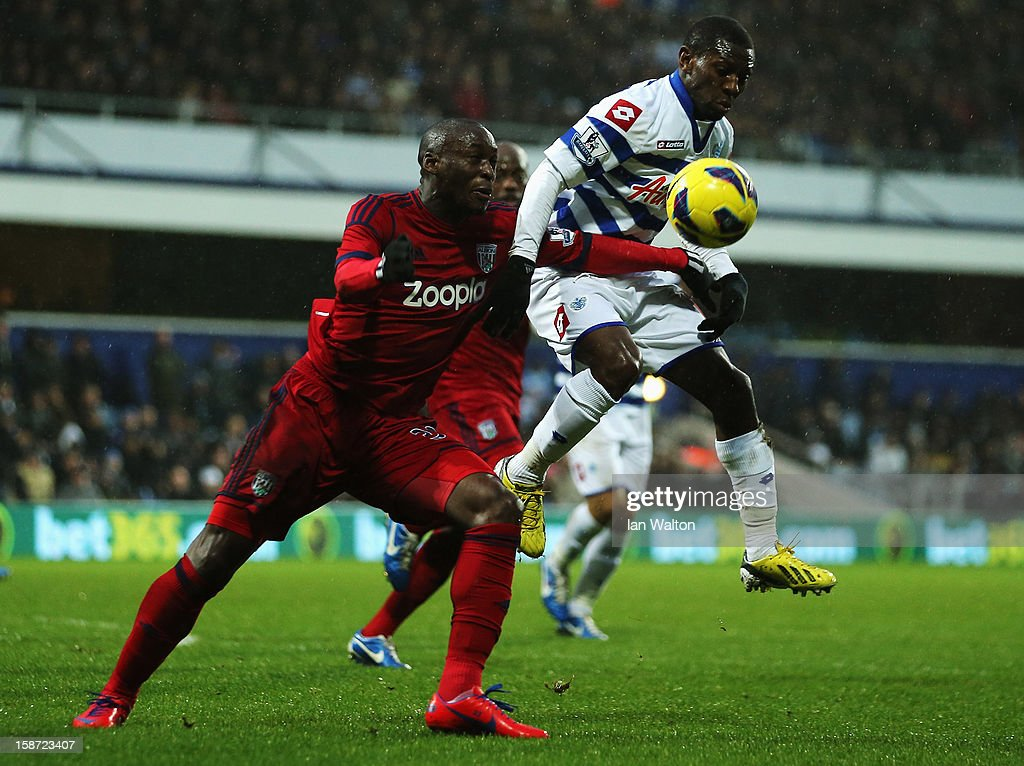 <a gi-track='captionPersonalityLinkClicked' href=/galleries/search?phrase=Marc-Antoine+Fortune&family=editorial&specificpeople=2463780 ng-click='$event.stopPropagation()'>Marc-Antoine Fortune</a> (L) of West Bromwich Albion and <a gi-track='captionPersonalityLinkClicked' href=/galleries/search?phrase=Shaun+Wright-Phillips&family=editorial&specificpeople=206237 ng-click='$event.stopPropagation()'>Shaun Wright-Phillips</a> (R) of Queens Park Rangers challenge for the ball during the Barclays Premier League match between Queens Park Rangers and West Bromwich Albion at Loftus Road on December 26, 2012 in London, England.