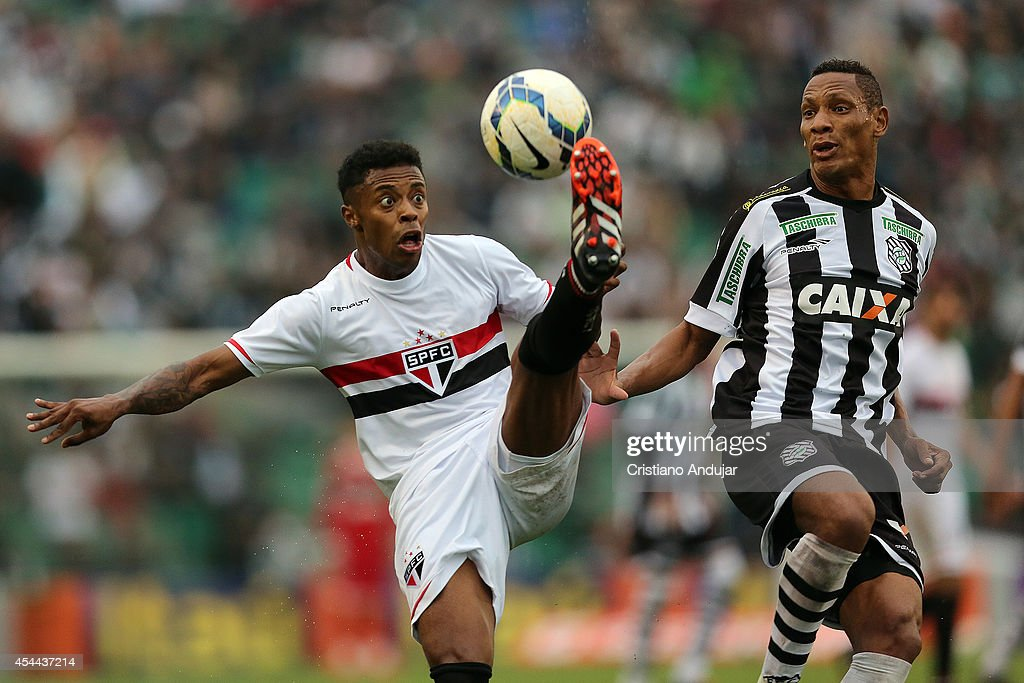 Marcao #29 of Figueirense try to take the ball of <a gi-track='captionPersonalityLinkClicked' href=/galleries/search?phrase=Michel+Bastos&family=editorial&specificpeople=1549621 ng-click='$event.stopPropagation()'>Michel Bastos</a> #7 of Sao Paulo during a match between Figueirense and Sao Paulo as part of Campeonato Brasileiro 2014 at Orlando Scarpelli Stadium on August 31, 2014 in Florianopolis, Brazil