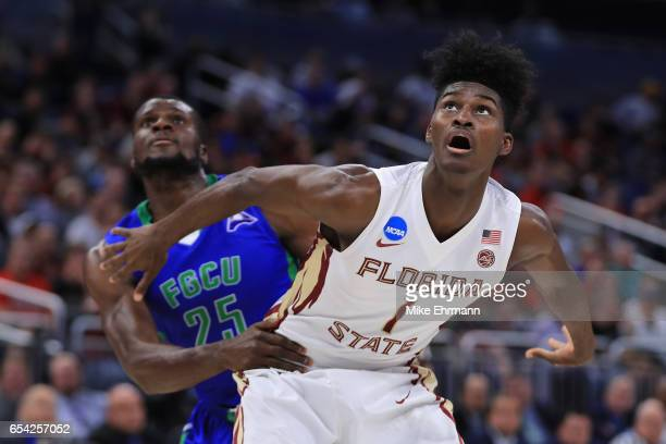 MarcEddy Norelia of the Florida Gulf Coast Eagles and Jonathan Isaac of the Florida State Seminoles battle for position during a free throw in the...