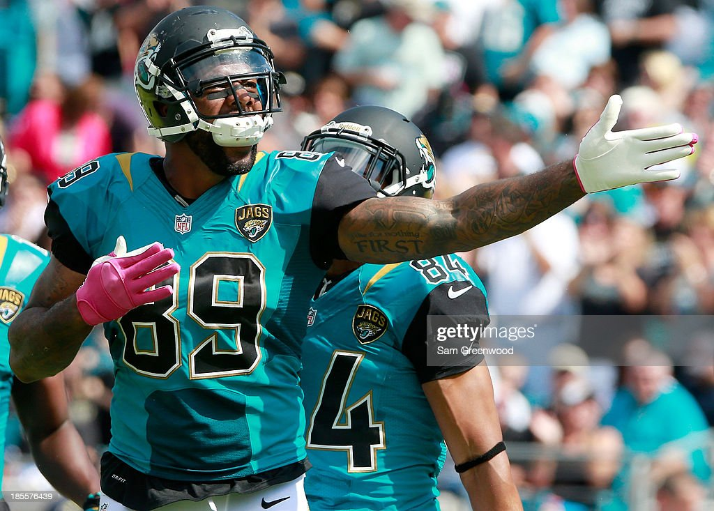 <a gi-track='captionPersonalityLinkClicked' href=/galleries/search?phrase=Marcedes+Lewis&family=editorial&specificpeople=453286 ng-click='$event.stopPropagation()'>Marcedes Lewis</a> #89 of the Jacksonville Jaguars celebrates a first down during the game against the San Diego Chargers at EverBank Field on October 20, 2013 in Jacksonville, Florida.