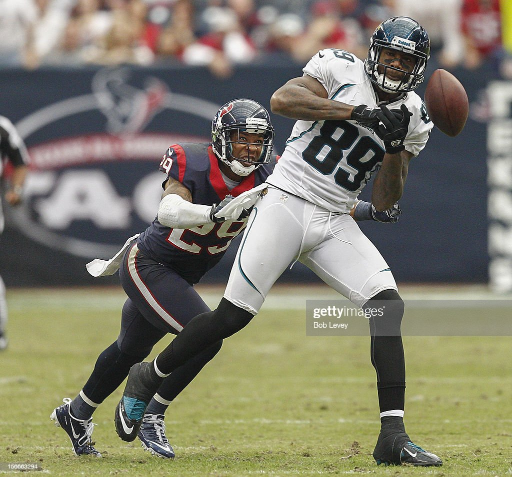 <a gi-track='captionPersonalityLinkClicked' href=/galleries/search?phrase=Marcedes+Lewis&family=editorial&specificpeople=453286 ng-click='$event.stopPropagation()'>Marcedes Lewis</a> #89 of the Jacksonville Jaguars has the ball slip through his hands as <a gi-track='captionPersonalityLinkClicked' href=/galleries/search?phrase=Glover+Quin&family=editorial&specificpeople=5732643 ng-click='$event.stopPropagation()'>Glover Quin</a> #29 of the Houston Texans at Reliant Stadium on November 18, 2012 in Houston, Texas. Houston wins 43-37 in overtime.