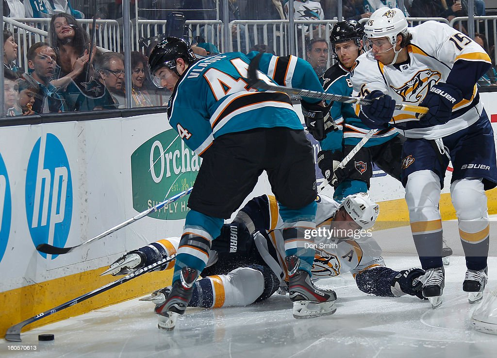 Marc-Edouard Vlasic #44 and Joe Pavelski #8 of the San Jose Sharks battle for the puck against Craig Smith #15 and David Legwand #11 of the Nashville Predators during an NHL game on February 2, 2013 at HP Pavilion in San Jose, California.