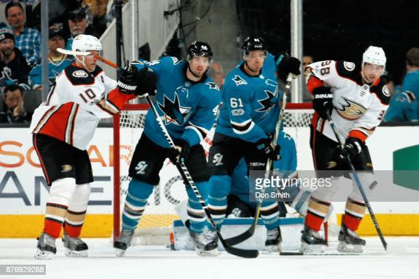 MarcEdouard Vlasic and Justin Braun of the San Jose Sharks defend the net against Corey Perry and Derek Grant of the Anaheim Ducks at SAP Center on...