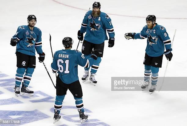 MarcEdouard Vlasic Justin Braun Joe Thornton and Joe Pavelski of the San Jose Sharks celebrate after Braun's goal in the first period of Game Three...