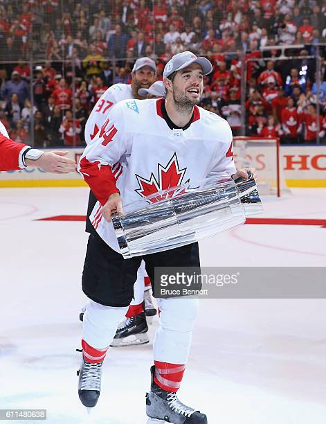 MarcEdouard Vlasic of Team Canada carries the World Cup of Hockey Trophy after Canada defeated Europe 21 during Game Two of the World Cup of Hockey...