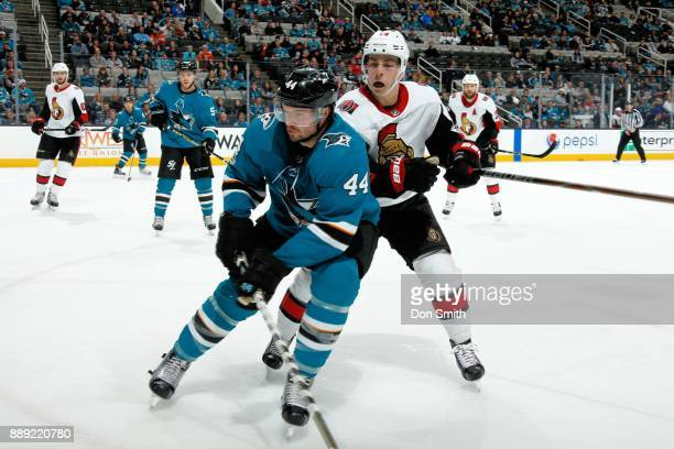 MarcEdouard Vlasic of the San Jose Sharks and JeanGabriel Pageau of the Ottawa Senators battle in the corner at SAP Center on December 9 2017 in San...