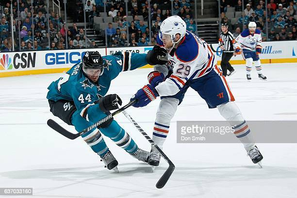 MarcEdouard Vlasic of the San Jose Sharks battles against Leon Draisaitl of the Edmonton Oilers during a NHL game at SAP Center at San Jose on...