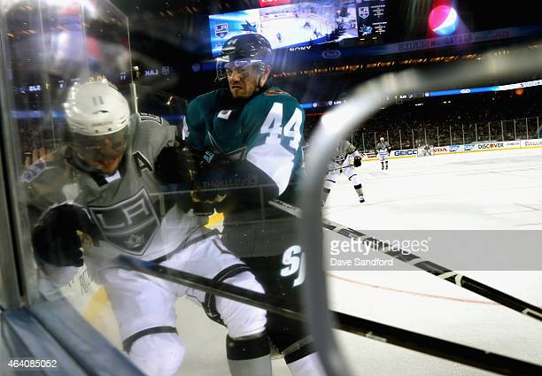 MarcEdouard Vlasic of the San Jose Sharks checks Anze Kopitar of the Los Angeles Kings during the first period of the 2015 Coors Light NHL Stadium...