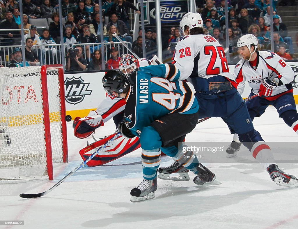 MarcEdouard Vlasic of the San Jose Sharks scores a goal against Tomas Vokoun Alexander Semin and Dennis Wideman of the Washington Capitals at HP...
