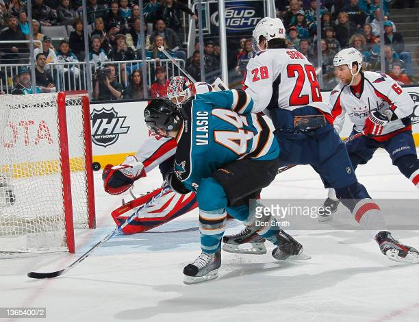 MarcEdouard Vlasic of the San Jose Sharks scores a goal against Tomas Vokoun Alexander Semin and Dennis Wideman of the Washington Capitals at HP...