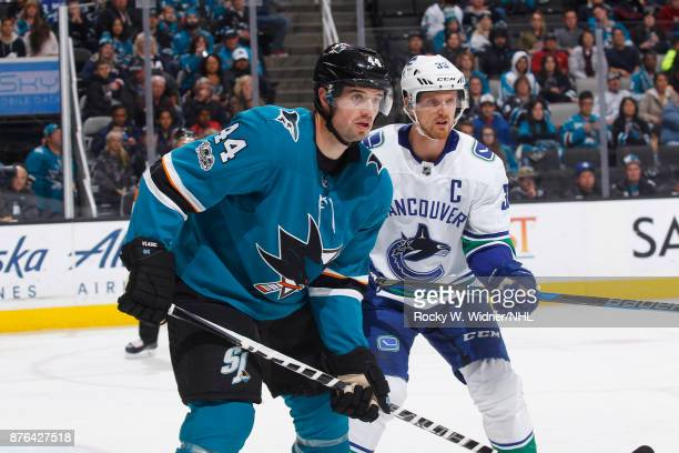 MarcEdouard Vlasic of the San Jose Sharks skates against Henrik Sedin of the Vancouver Canucks at SAP Center on November 11 2017 in San Jose...