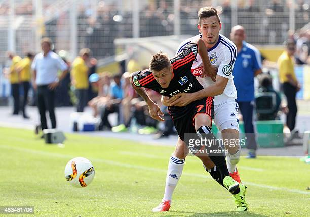 Marcel Baer of Jena challenges Ivo Ilicevic of Hamburger SV during the First Round of DFBCup between FC Carl Zeiss Jena and Hamburger SV at...