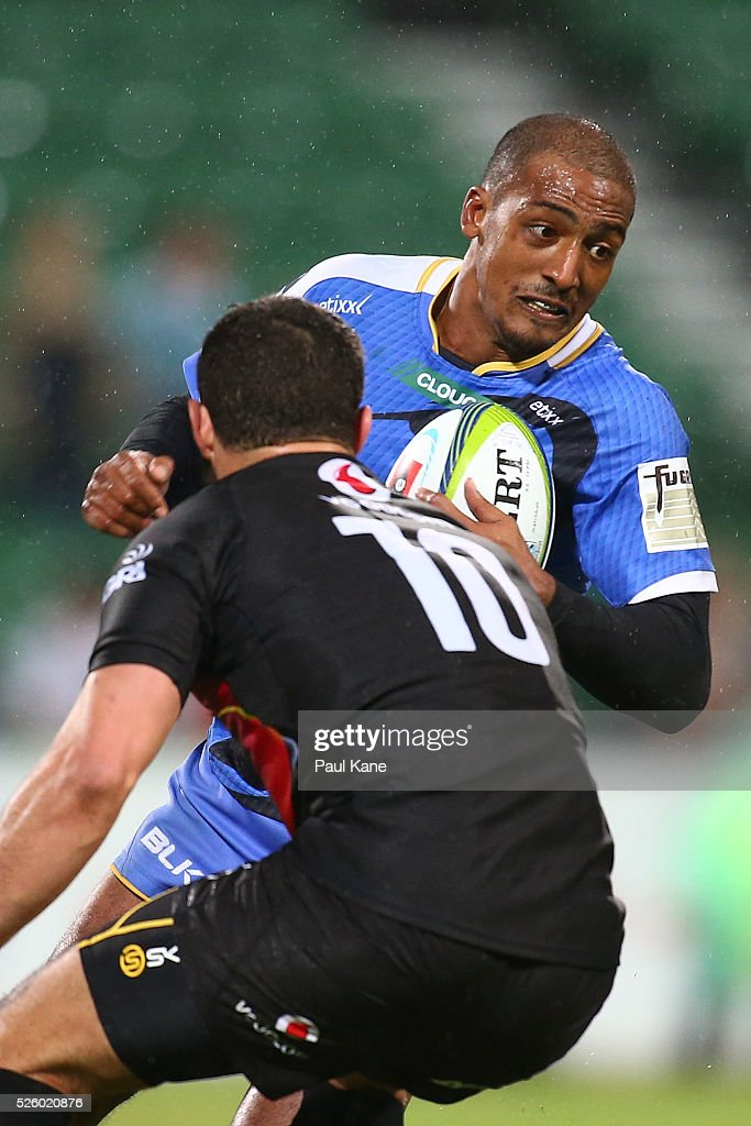 Marcel Brache of the Force looks to avoid being tackled by Francois Brummer of the Bulls during the round 10 Super Rugby match between the Force and the Bulls at nib Stadium on April 29, 2016 in Perth, Australia.