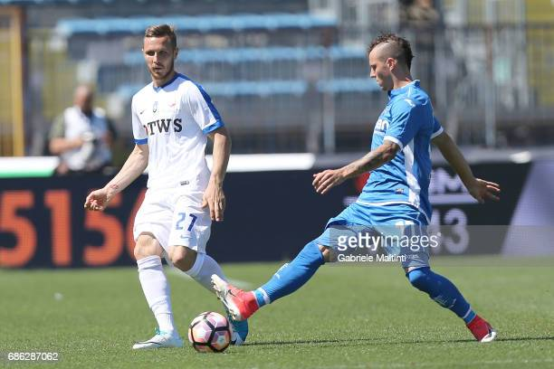Marcel Buchel of Empoli FC battles for the ball with Jasmin Kurtic of Atalanta BC during the Serie A match between Empoli FC and Atalanta BC at...