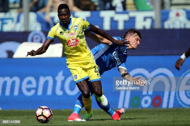 Marcel Buchel of Empoli Fc battles for the ball with Mamadou Coulibaly of Pescara Calcio during the Serie A match between Empoli FC and Pescara...