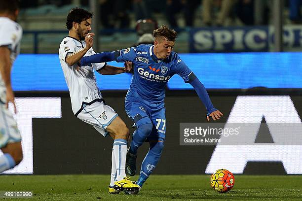 Marcel Buchel of Empoli FC battles for the ball with Marco Paolo of SS Lazio during the Serie A match between Empoli FC and SS Lazio at Stadio Carlo...