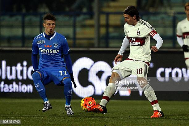 Marcel Buchel of Empoli FC battles for the ball with Riccardo Montolivo of AC Milan during the Serie A match between Empoli FC and AC Milan at Stadio...